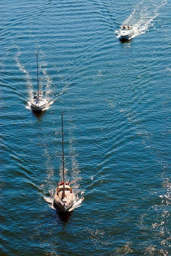 Sailboats and motor boats on the Nord_Ostsee_Kanal, Kiel Canal, Kiel, Schleswig_Holstein, Germany, Europe : Stock Photo