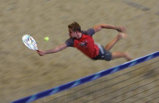 Beach Tennis in a hall, motion blur : Stock Photo