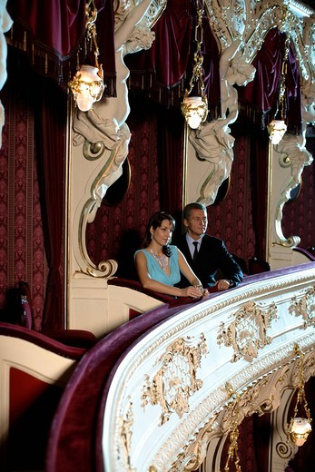 Couple seated in a theatre box, opera : Stock Photo