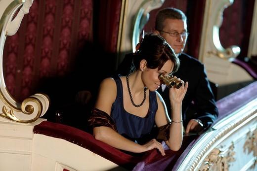 Couple seated in a theatre box, opera : Stock Photo