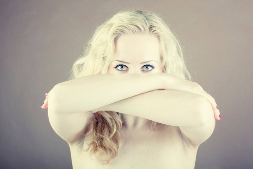 Stock Photo: 1848-464320 Blond_haired woman, Gothic style, naked torso, with a serious expression