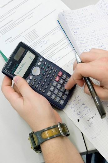 Stock Photo: 1848-465120 Written documentation and analysis with a calculator, first year apprentice, chemical laboratory worker, AlzChem Trostberg GmbH, Trostberg, Bavaria, Germany, Europe