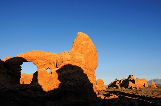 Turret Arch, hiker, South Window, Arches National Park, Moab, Utah, USA : Stock Photo