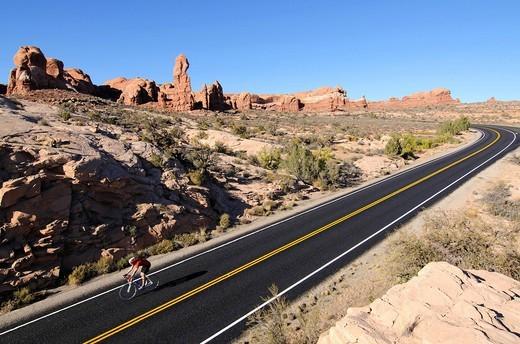 Race cyclist, Arches National Park, Moab, Utah, USA : Stock Photo
