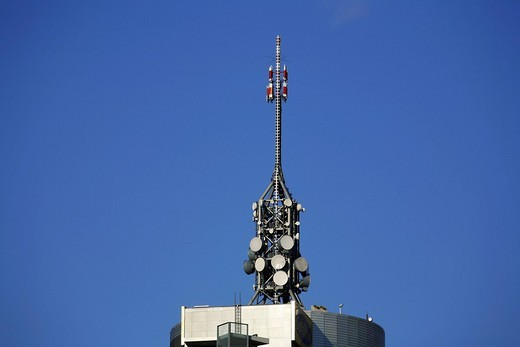 Stock Photo: 1848-46643 Mobile phone antenna transmitter mast on a roof