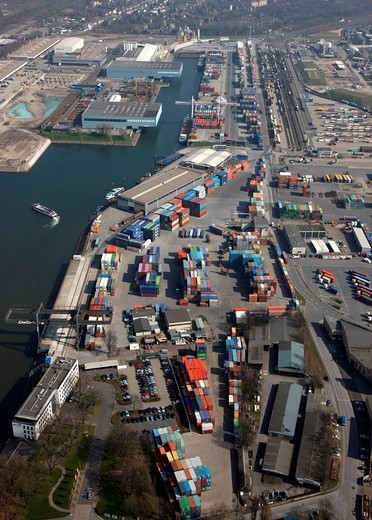 Duisport, port and logistics center, Ruhrort inland port on the Rhine river, largest inland port in the world, DeCeTe container terminal, transshipment of containers to ships, road and rail, Duisburg, North Rhine_Westphalia, Germany, Europe : Stock Photo