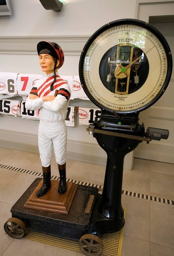 Figure of a jockey standing on historical scales, Grafenberg racecourse, Duesseldorf, North Rhine_Westphalia, Germany, Europe : Stock Photo