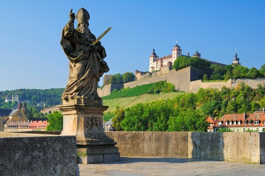 Marienberg Fortress and statue of St. Kilian, on the old Mainbruecke Bridge, Wuerzburg, Bavaria, Germany, Europe : Stock Photo
