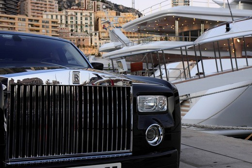 Rolls_Royce in front of luxury yachts in the harbor of La Condamine, Principality of Monaco, Cote d´Azur, Europe : Stock Photo