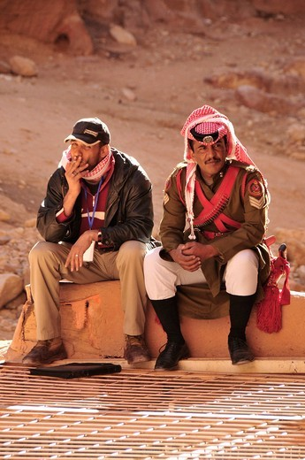 Bedouin police officer in front of the treasury, Khazne Faraun, in the Nabataean city Petra, Unesco World Heritage Site, near Wadi Musa, Jordan, Middle East, Orient : Stock Photo