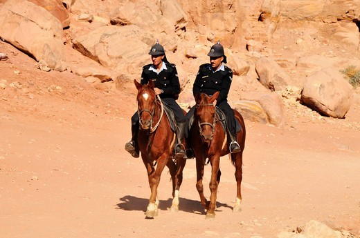 Two officers of the tourist police on horses, Nabataean city of Petra, Unesco World Heritage Site, near Wadi Musa, Jordan, Middle East, Orient : Stock Photo
