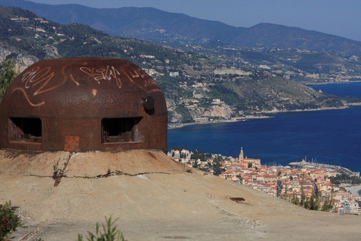 Gun turret of a fort of the Maginot Line in Roquebrune Cap Martin, Menton at back, Département Alpes Maritimes, Région Provence Alpes Côte d´Azur, France, Europe : Stock Photo