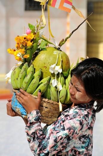 Stock Photo: 1848-469688 Girl carrying offerings, Botataung Pagoda, Yangon, Burma, Myanmar, Southeast Asia