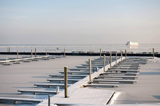 The fully frozen marina of Wyk on the North Sea island of Foehr, Nationalpark Schleswig_Holsteinisches Wattenmeer, Schleswig_Holstein Wadden Sea National Park, Unesco World Heritage Site, North Frisian islands, Schleswig_Holstein, northern Germany, Europe : Stock Photo