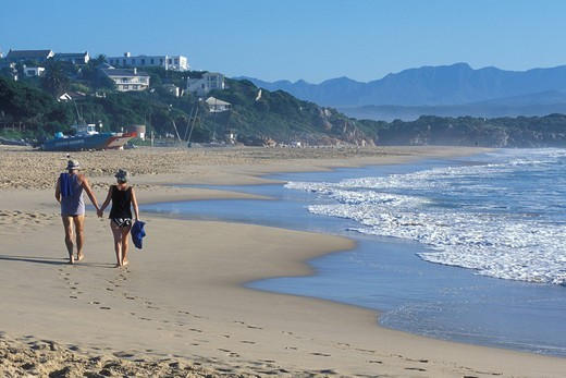 Older couple walking on the beach in Plettenberg Bay, Garden Route, Western Cape, South Africa, Africa : Stock Photo