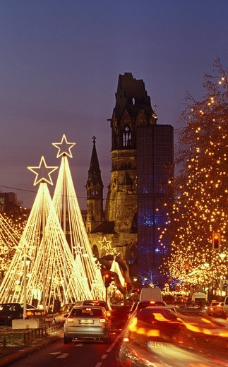 Tauentzienstrasse strasse and Kaiser_Wilhelm_Gedaechtniskirche, Kaiser Wilhelm Memorial Church at Breitscheidplatz square at Christmas time with fairy lights, Charlottenburg district, Berlin, Germany, Europe : Stock Photo