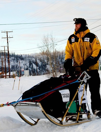 Stock Photo: 1848-471666 Dog musher Zack Steer leaving Dawson City, Yukon Quest 1, 000_mile International Sled Dog Race 2010, Yukon Territory, Canada