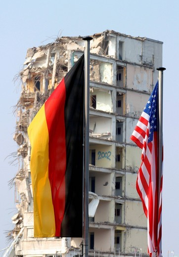 Stock Photo: 1848-471988 German and American flag in front of a demolished house, Cologne, North Rhine_Westphalia, Germany, Europe