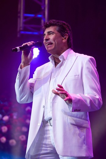 Renato Wohllaib, singer and frontman of the austrian pop folk band ´Die Paldauer´, live at the 10th Schlager music night in the new festival hall Allmend, Lucerne, Switzerland : Stock Photo