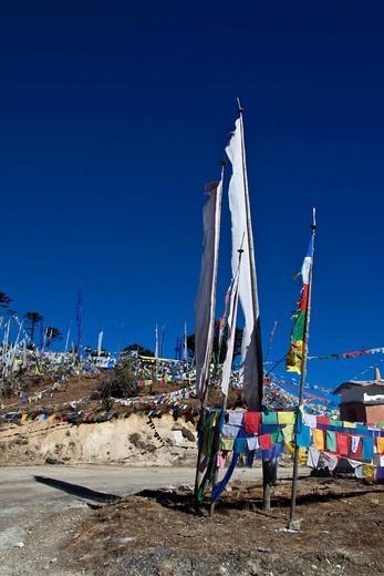 Prayer flags at Trumshingla pass, Bhutan, South Asia : Stock Photo