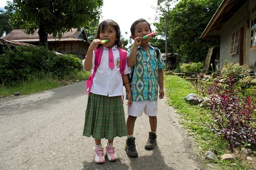 Stock Photo: 1848-473331 Girl and boy eating ice cream in a street in Rantepao, Sulawesi, Indonesia, Southeast Asia