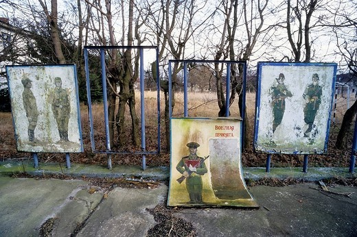 Stock Photo: 1848-473621 Weathered posters with Soviet soldiers, relics at the former barracks of the Soviet Armed Forces at the Wustrow Rerik Peninsula, Coast of the Baltic Sea, Mecklenburg_Western Pomerania, Germany, Europe