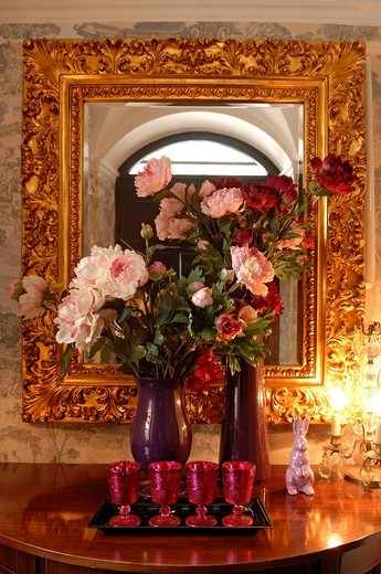 Bouquet of artificial fabric peonies in front of a mirror with gold frame, Villa & Ambiente, Im Weller 28, Nuremberg, Middle Franconia, Bavaria Germany, Europe : Stock Photo