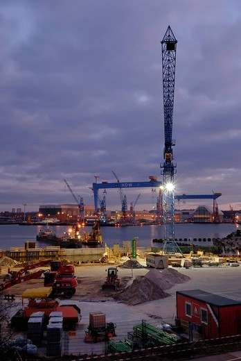 Construction of the Ostseekai cruise terminal with HDW dockyard cranes behind it, Kiel, Schleswig_Holstein, Germany, Europe : Stock Photo