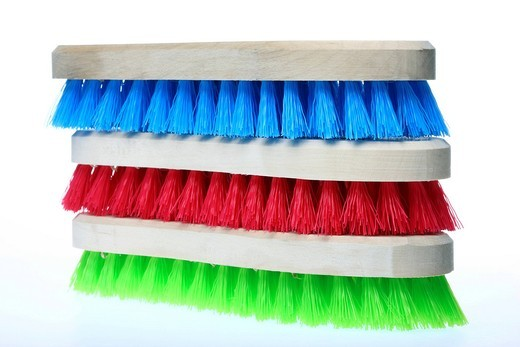 Colourful scrubbing brushes, wooden with plastic bristles : Stock Photo
