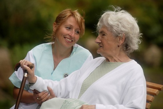Old woman with nurse : Stock Photo