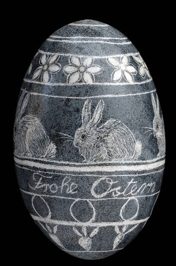 Happy Easter motif and hare image on a chicken egg, scratched : Stock Photo