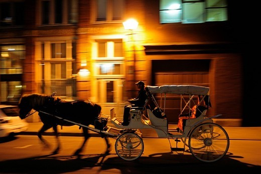 Stock Photo: 1848-477513 Horse_drawn carriage for tourists driving at night through the streets of the historic old town of Montreal, Quebec, Canada