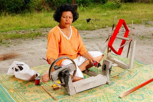 Stock Photo: 1848-477816 Woman at a spinning wheel, Batak culture, Samosir island, Lake Toba, Batak region, Sumatra, Indonesia, Asia