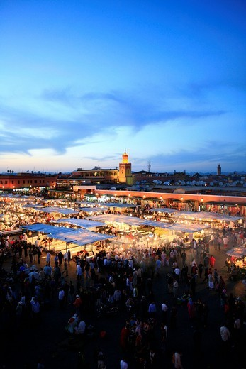 Stock Photo: 1848-479892 Djemaa el_Fna, Square of the Hanged Man in the medina quarter of Marrakech at dusk with its countless food stalls, Marrekech, Morocco, Africa
