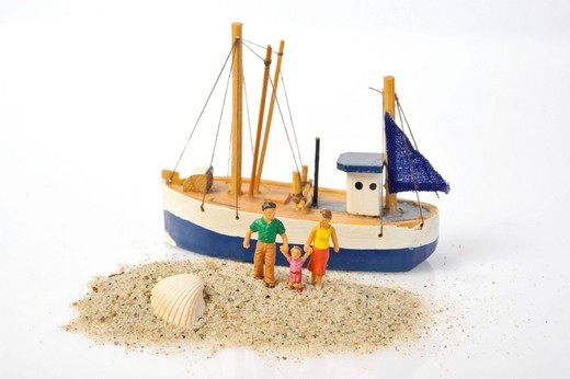 Stock Photo: 1848-481416 Family figurines in sand in front of a boat