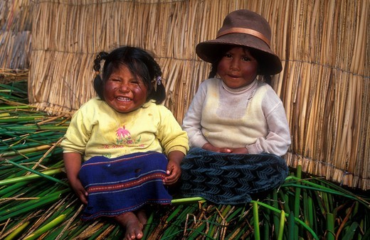 Two little girls, 5 and 6 years, on a reed island made from Totora reeds, Aymara ethnic group, Lake Titicaca, Peru, South America : Stock Photo