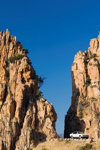 Stock Photo: 1848-483160 Road through red porphyry rocks, Calanche de Piana, Gulf of Porto, Corsica, France, Europe