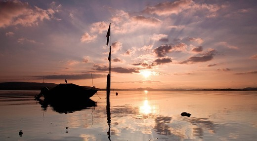 Stock Photo: 1848-483425 Sunset on Reichenau island with fishing boat and cloud reflection, Baden_Wuerttemberg, Germany, Europe