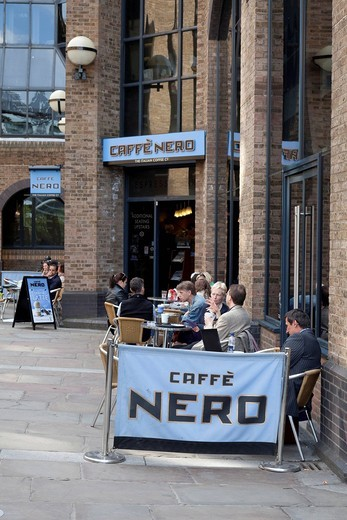 People sitting in a street cafe of the Caffe Nero coffee shop chain, London, Great Britain, Europe : Stock Photo