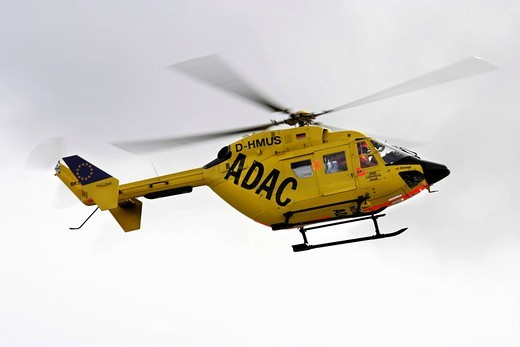 ADAC rescue helicopter in flight, island of Juist, Lower Saxony, Northern Germany, Europe : Stock Photo