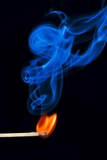 Stock Photo: 1848-484637 Lit match, flame and blue smoke