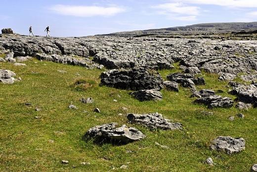Tourists on the Burren landscape, Republic of Ireland, Europe : Stock Photo