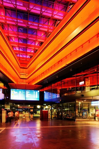 Neon_lit entrance hall of the train station in Zug, Switzerland, Europe : Stock Photo