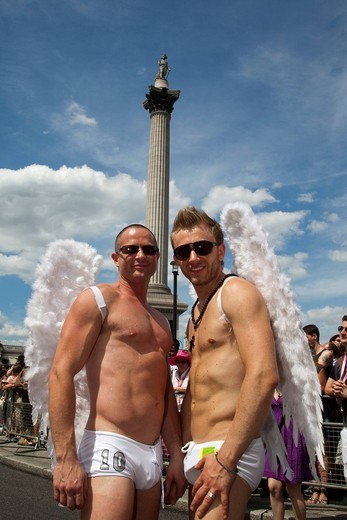 Two gay men with angel wings in front of Nelson´s Column, Trafalgar Square, Pride London 2010, Gay Love Parade, London, England, United Kingdom, Europe : Stock Photo