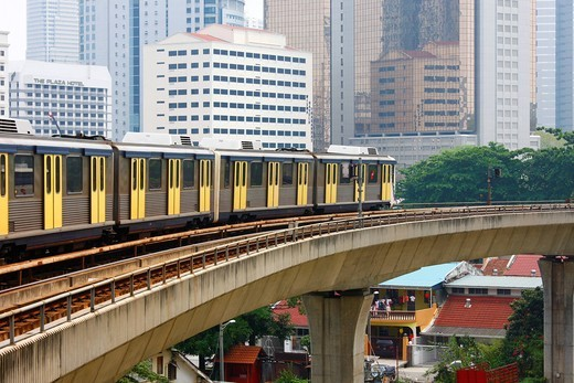 RapidKL Light Rail train runs through the historic district above the streets, Masjid Jamek station, Kuala Lumpur, Malaysia, Asia : Stock Photo