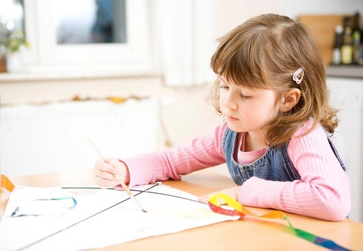 Stock Photo: 1848-487307 A girl painting with water colours