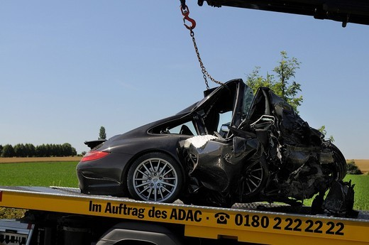 Completely smashed wreck of a Porsche Carrera S after a serious car accident, Markgroeningen, Baden_Wuerttemberg, Germany, Europe : Stock Photo