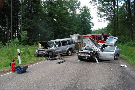 Car wrecks after a head_on collision on the K 1209 county road, Kaiserstrasse, direction Goldboden, Lichtenwald, Baden_Wuerttemberg, Germany, Europe : Stock Photo