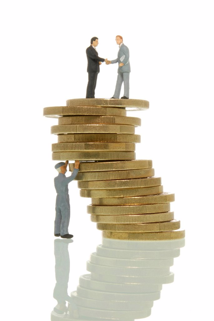 Worker figure propping up a wobbly stack of Euros with two business man figures on top, symbolic image, Euro crisis at the expense of the workers : Stock Photo