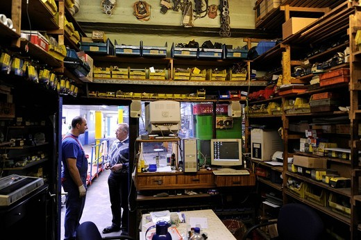 Stock Photo: 1848-489716 Spare parts stockroom, mechanics at work, garage